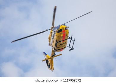 FELDKIRCHEN / GERMANY - JUNE 09, 2018: Eurocopter EC-135 from ADAC Luftrettung flies over landing side. Notarzt means emergency doctor.