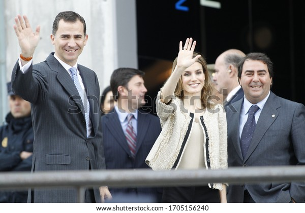 Coruña-Spain.King Felipe VI and Queen Leticia smile smilingly at the exit of an event in La Coruña on May 4, 2012