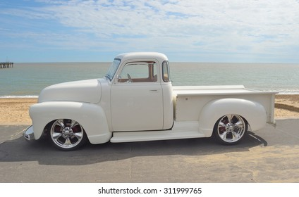 FELIXSTOWE, SUFFOLK, ENGLAND - AUGUST 29, 2015: White 1952 Chevrolet pickup on show at Felixstowe seafront.