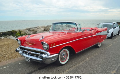 FELIXSTOWE, SUFFOLK, ENGLAND - AUGUST 29, 2015: Classic Red Chevrolet Belair convertible on show on Felixstowe seafront.
