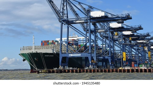 """FELIXSTOWE, SUFFOLK, ENGLAND - FEBRUARY 29, 2020: Large Container Ship """"Ever Given""""  being loaded at Felixstowe Port."""