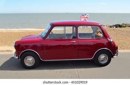 FELIXSTOWE, SUFFOLK, ENGLAND - MAY 01, 2016: Classic Red Austin Mini motor car parked on  Felixstowe seafront promenade.