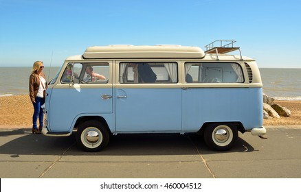 FELIXSTOWE, SUFFOLK, ENGLAND - MAY 01, 2016: Classic Blue and white Volkswagen camper van parked on  Felixstowe seafront promenade with on lookers.