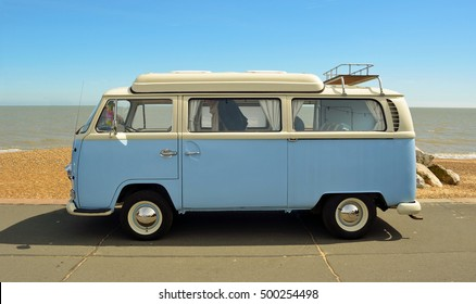 FELIXSTOWE, SUFFOLK, ENGLAND - MAY 01, 2016: Classic Blue and white Volkswagen camper parked on  Felixstowe seafront promenade.