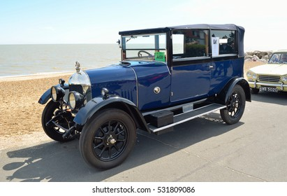 FELIXSTOWE, SUFFOLK, ENGLAND - MAY 01, 2016: Classic Blue Morris Oxford motor car on seafront promenade.