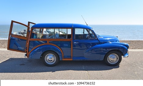 FELIXSTOWE, SUFFOLK, ENGLAND - MAY 06, 2018:  Classic Blue Morris Minor 1000  Traveller Parked on seafront Promenade.