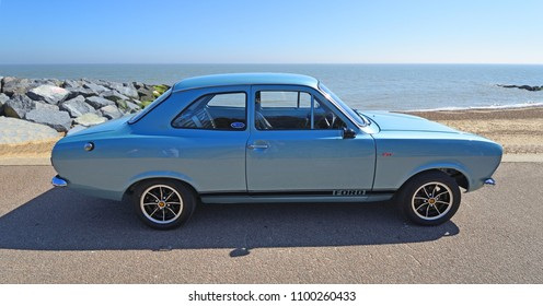 FELIXSTOWE, SUFFOLK, ENGLAND -  MAY 06, 2018: Classic Silver Ford Escort Motor Car Parked on Seafront Promenade.