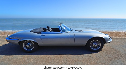 FELIXSTOWE, SUFFOLK, ENGLAND -  MAY 06, 2018: Classic Silver Jaguar  E  Type convertible  Motor Car Parked on Seafront Promenade.