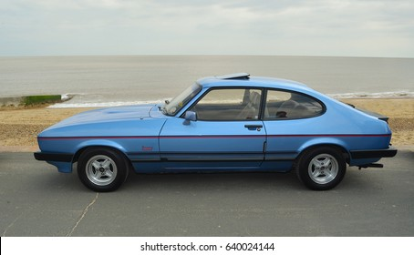 FELIXSTOWE, SUFFOLK, ENGLAND -  MAY 07, 2017:  Classic Blue Ford Capri  Laser Motor Car Parked on seafront promenade.