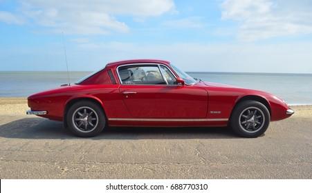 FELIXSTOWE, SUFFOLK, ENGLAND -  MAY 07, 2017: Classic Red Lotus  Elan +2  Motor Car Parked on Seafront Promenade.