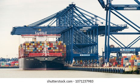 Felixstowe, Suffolk, England, UK - May 28, 2017: The Port of Felixstowe with some cranes, containers and a container ship