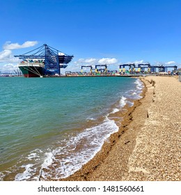 Felixstowe, Suffolk, UK - 18 August 2019: Bright summer Sunday afternoon. The Ever Govern Evergreen container ship docked at the Port of Felixstowe.