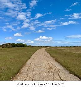 Felixstowe, Suffolk, UK - 18 August 2019: Bright summer Sunday afternoon. Path through Landguard Point nature reserve.