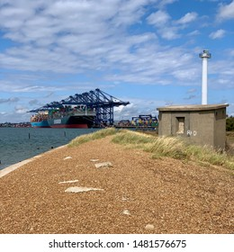 Felixstowe, Suffolk, UK - 18 August 2019: Bright summer Sunday afternoon. A view of the port from across the Landguard point nature reserve.