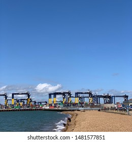 Felixstowe, Suffolk, UK - 18 August 2019: Bright summer Sunday afternoon. Colourful containers and equipment at the port.