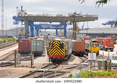 FELIXSTOWE, SUFFOLK, UK - JUNE 30, 2012: Freightliner's Class 08 Shunter No. 08585 'Vicky' runs through the yard at Felixstowe Docks, preparing trains of intermodal stock for movement into the UK.