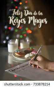 """FELIZ DIA DE LOS REYES MAGOS, spanish translation of HAPPY WISE MEN DAY:  Kid wrinting a letter with the words """"QueridosReyes magos"""" translation of DEAR WISE MAN, AT EPIPHANY, COOKIES FOR THEM"""