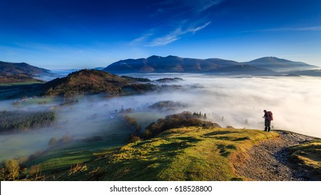 Fell walker ascending Catbells, The Lake District, Cumbria, England