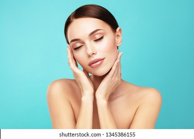 Felling clean and fresh. Skin care,Beauty treatment and spa concept. Attractive model with brown hair and  perfect Skin touch own face  with closed eye