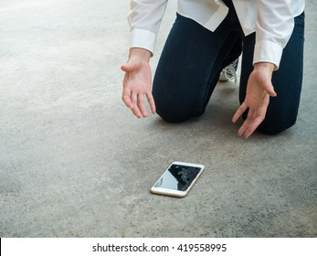 Felling Sad Person Drop Smartphone on Floor with Copy Space