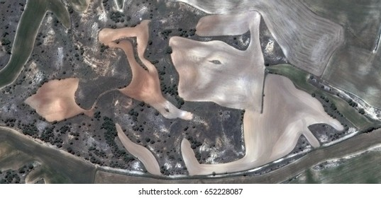 fellow of hardships,allegory, tribute to Matisse, Picasso, abstract photography of the Spain fields from the air, aerial view, representation of human labor camps, abstract, cubism,abstract naturalism