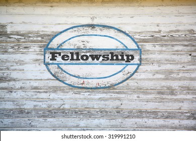 Fellowship concept - road sign on shed side