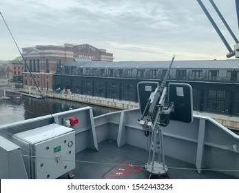 Fells Point, Maryland / US - October 26, 2019: French flagged support vessel the FS Garrone's single .50 cal Browning M2 armament overlooks Baltimore while docked briefly during its maiden voyage