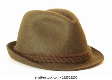 felt dark green hat on white background