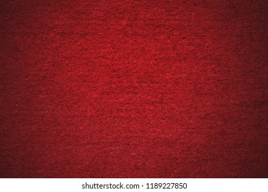 Felt fabric in red color for New Year and Christmas background.