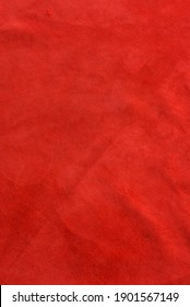 Felt material macro. Red suede texture. Fabric, leather, material for designers.