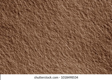 Felt surface in brown color. Abstract background and texture for design.