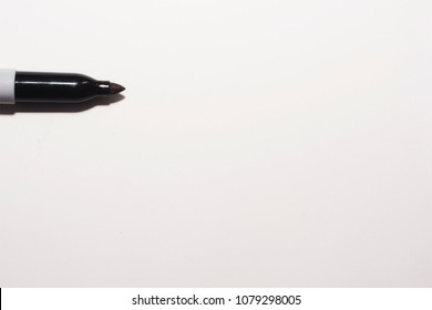 A felt tip permanent marker pen horizontal on a white page background, with plenty of copy space.