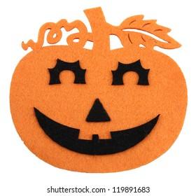 Felted orange and black halloween decoration on white