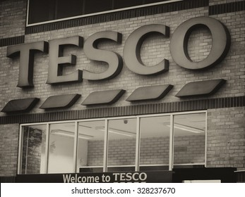 Feltham, London, Middlesex, England - August 04, 2015: Tesco supermarket sign over main entrance to store, company founded by Jack Cohen in 1919