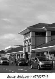 Feltham, London, Middlesex, England - July 14, 2017: Monochrome Tesco Extra supermarket store, company founded by Jack Cohen in 1919