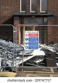 Feltham, London, Middlesex, England - October 20, 2015: J mould Demolition Company based in Reading Berkshire, demolition of building on Falcon Estate
