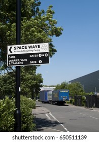 Feltham, Middlesex, England - May 26, 2017: Space Waye recycling centre roadside direction sign mounted on lamppost