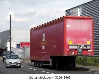 Feltham, Spur Road, London, Middlesex, England - September 11, 2015: Royal Mail HGV trailer parked at side of road, UK based postal service established in 1516