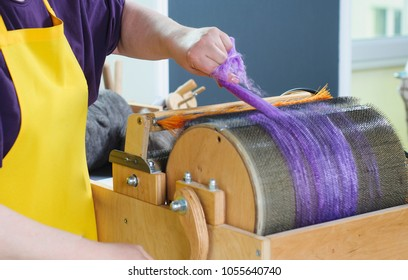 Felting wool. The step of combing the material in a special carding machine.