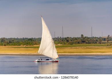 Felucca egyptian boat traversing the Nile near Aswan