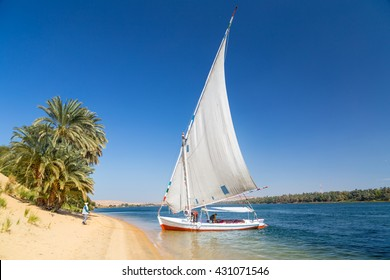 Felucca, traditional wooden sailboat on shore of Nile, Egypt.