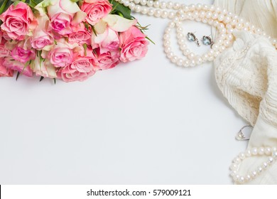 Female accessories with freah roses bouquet and copy space