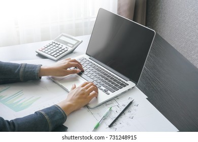female accountant typing message with computer laptop in home office .concept of business people work from anywhere with technology