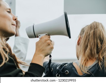 Female activist shouting on a megaphone