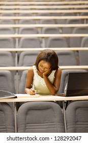 female african american university student sitting in lecture room