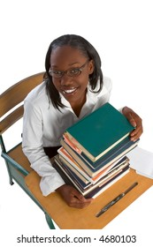 Female African-American Student by stack of books