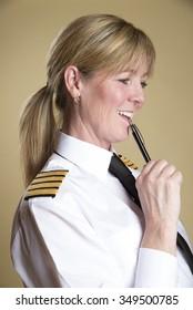 Female airline pilot holding a pen