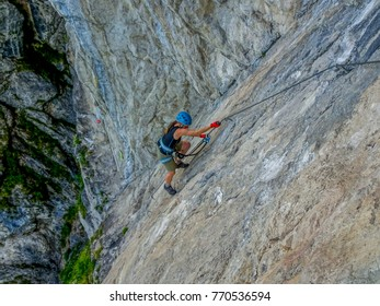 Female alpinist climbing the via ferrata at the Reinthalersee in Tirol/Austria, photographed in the steepest section of the route