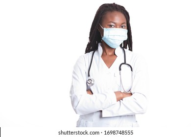 Female american african doctor, nurse woman wearing medical coat with stethoscope and mask. Happy excited for success medical worker posing on light background. Pandemia concept, covid 19