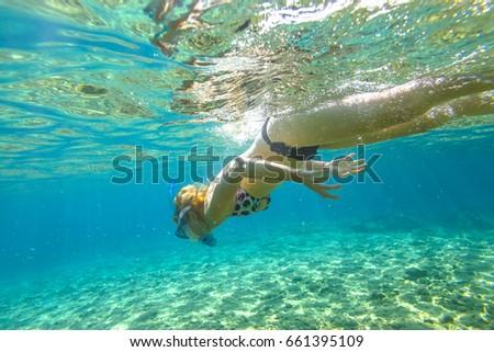 Underwater bikini strip